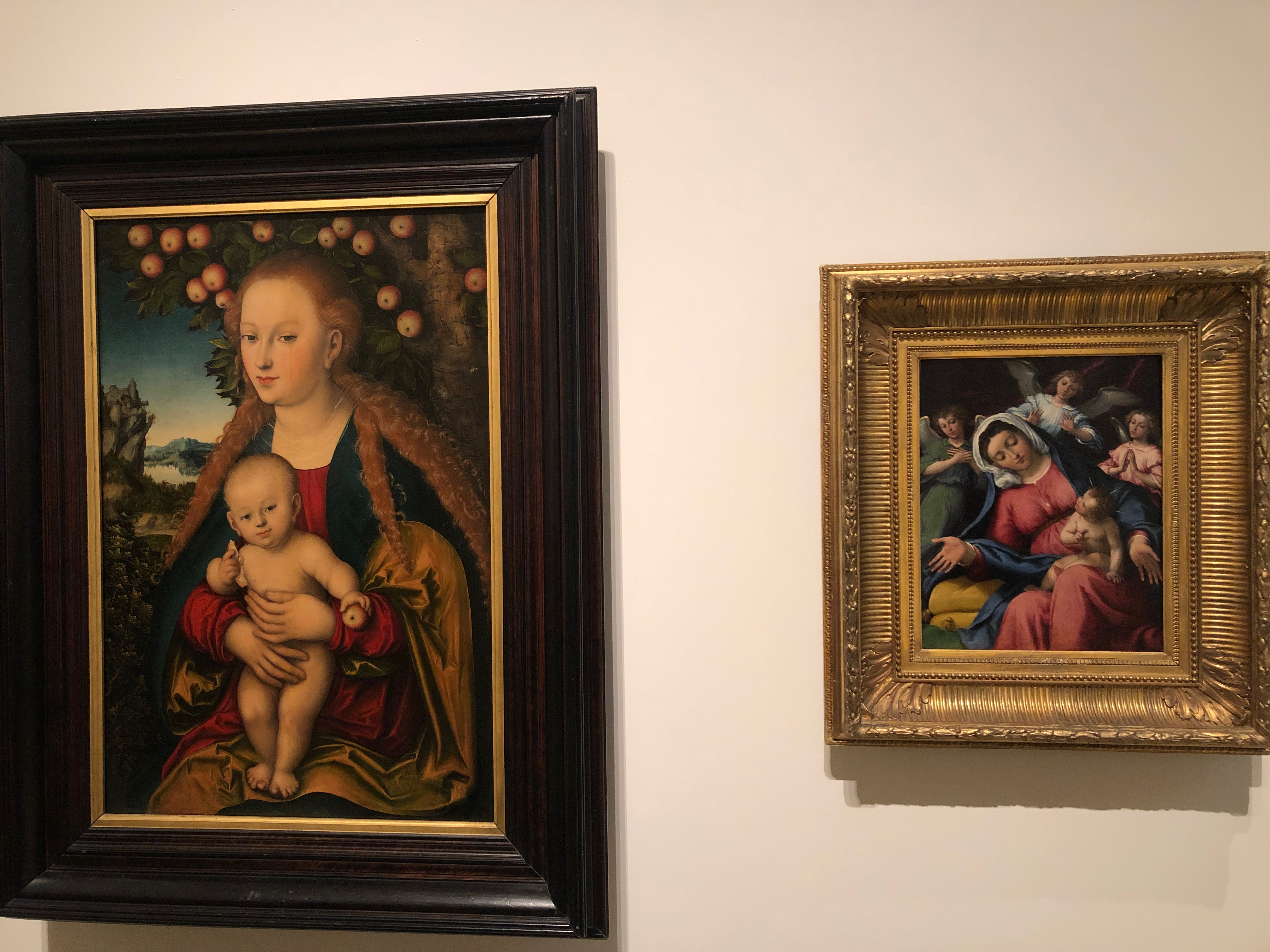 Mary and the Christ Child under the Apple Tree,  Lucas Cranach the Elder, 1527-30 (on the left); Madonna delle Grazie, Lorenzo Lotto, 1542 (on the right)